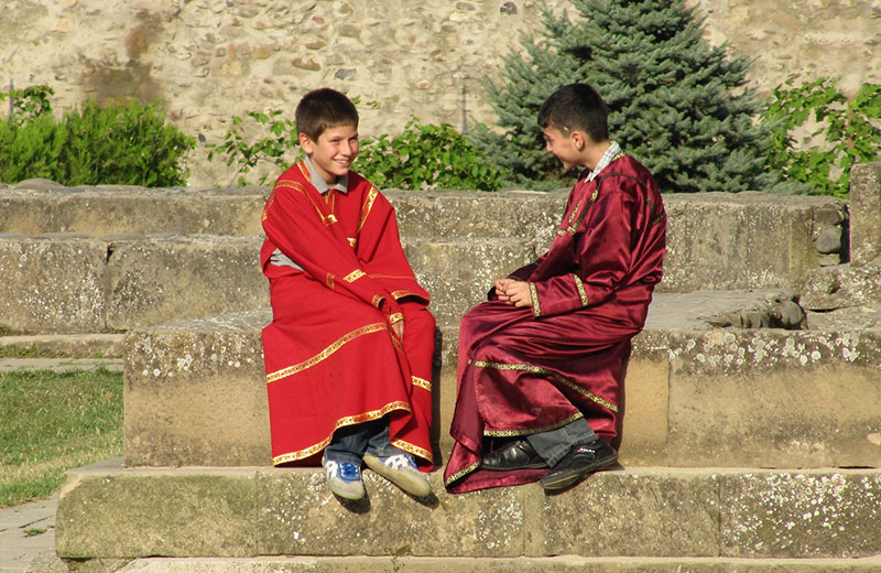 Two Georgian boys talking to each other